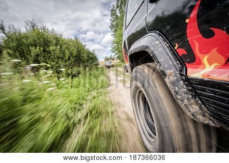 Offroad car moving with high speed in motion blur
