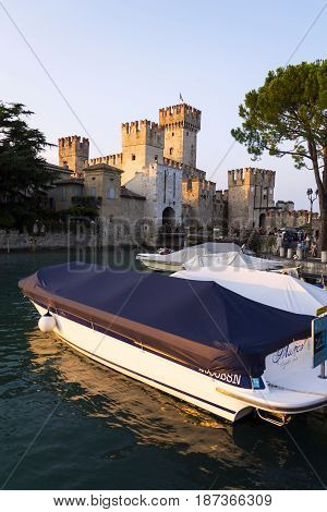 Sirmione, Italy - July 30: Boats Floating In Front Of Scaliger Castle On 30 July 2016 In Sirmione, I