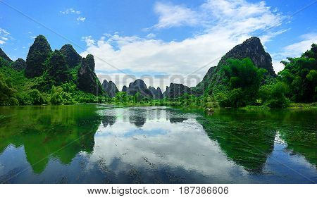 Jagged mountain peaks of Yangzhou in Southern China reflecting on the water