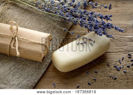 Lavender soap bars with dried lavender on a wooden background with sackcloth