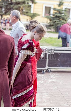 NIZHNY NOVGOROD, RUSSIA  May 20, 2017: Night of museums festival. Ladies and gentlemen, after performing at the main stage in costumes of the 19th century. NIZHNY NOVGOROD