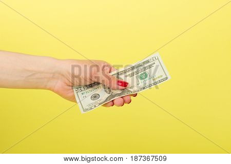 Twenty Dollars In The Woman's Hand, Yellow Background