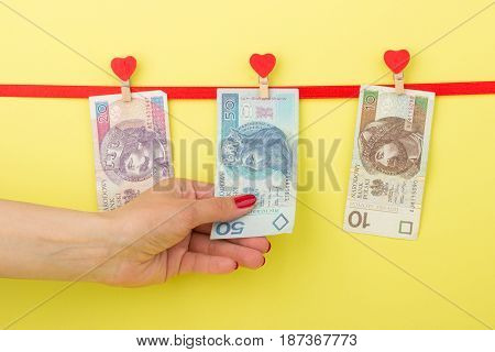 Fifty, Twenty, Ten Zloty Hangs On The Clothespins, Yellow Background