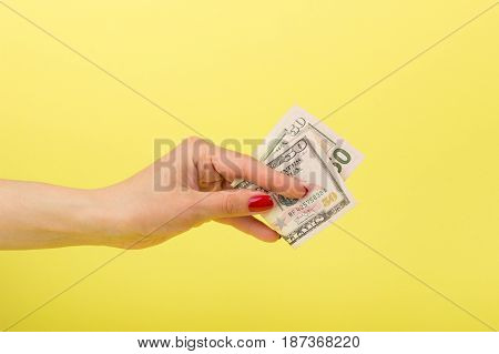 Fifty Dollars And Euro In The Woman's Hand, Yellow Background