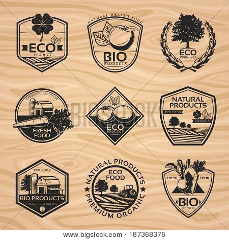 Vintage natural labels collection with bio organic healthy products plants and farming elements on wooden background isolated vector illustration