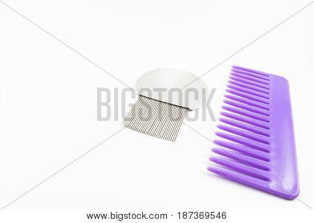 A violet comb and a fine comb.