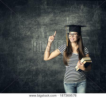 Student in Graduation Hat Finger Point Master Girl in Glasses Mortarboard over Blackboard University Education
