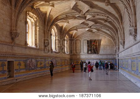 LISBON, PORTUGAL - MAY 11, 2017: People in the refectory of Jeronimos Monastery. Since 1983, the monastery is listed as UNESCO World Heritage site
