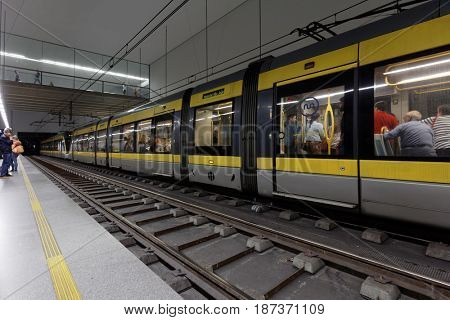 PORTO, PORTUGAL - MAY 8, 2017: People in the train on the central metro station Trindade. Metro do Porto is one of the largest light rail networks in Europe