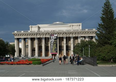 NOVOSIBIRSK, RUSSIA - JULY 30, 2014: People in front of the Novosibirsk Opera and Ballet Theater. It's the largest theatrical building in Russia