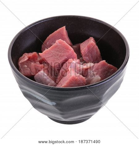 Fresh Raw Beef Cubes In Black Bowl Isolated On White Background