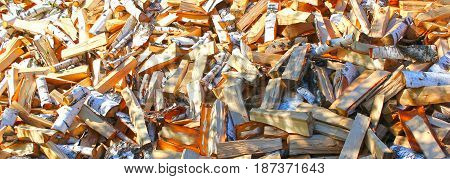 Natural wooden background close-up of chopped firewood. Text caption