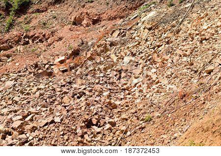 Broken stone wall after earthquake or landslide