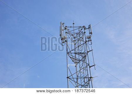 Antenna phone tower on blue sky background
