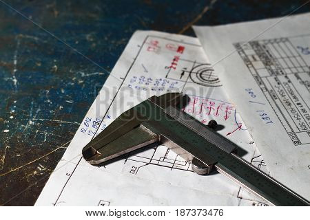 old vernier calipers on drawing plan with mini space