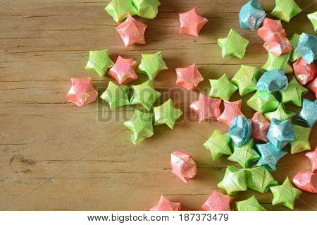 colorful star paper spreading on wooden background