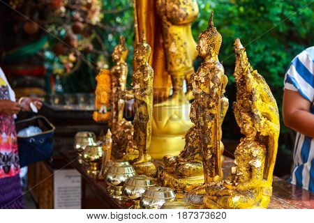 golden buddha statue with real gold leaf old but beauty
