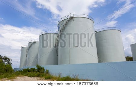 storage tanks for petroleum productsFuel oil tanker blue sky background