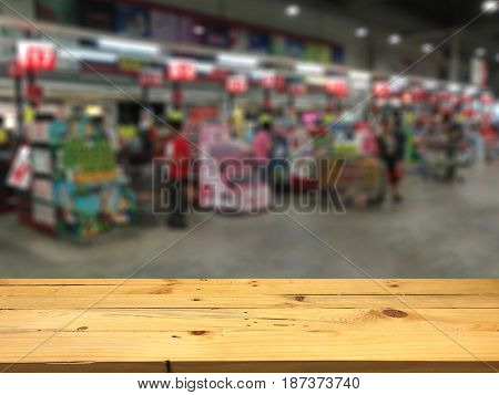 Empty wooden table space platform and blurred Cashier Supermarket background for product display montage.