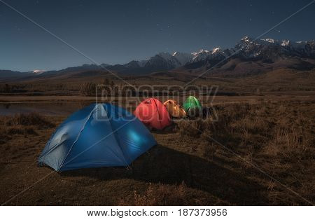 Colorful tourist tents on the background of the autumn mountain landscape, Altai region, Siberia, Russia
