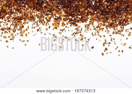 Brown Amber stones border on white background, copy space. Frame of natural gems. Beauty, jewelry concept