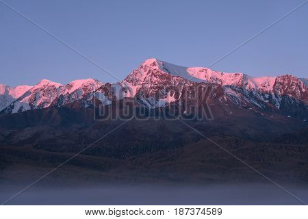 Tops of mountains sparkling by rising sun, Altai region, Siberia, Russia