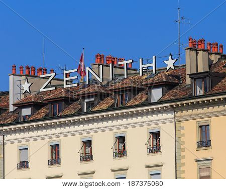 Geneva, Switzerland - 24 September, 2016: upper part of a building bearing Zenith sign on its roof. Zenith is a Swiss watchmaker, founded in 1865.