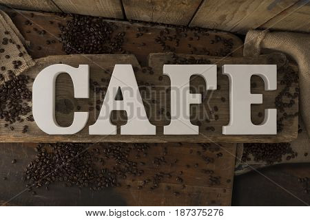 3D Letters Spelling Cafe On Rustic Wooden Surface