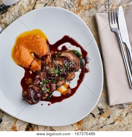 Duck breast Magret with mashed nutmeg pumpkin dressed with porto sauce