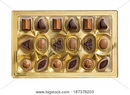 Chocolate candies in box isolated on white. Top view.
