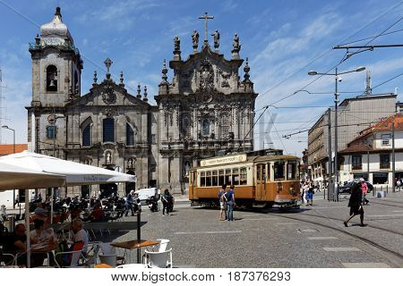 PORTO, PORTUGAL - MAY 8, 2017: People in heritage trams on the Carlos Alberto square. First trams in the city with electric traction was introduced in 1895