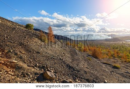 Bald mountain, ecological disaster, the effects of air pollution. City in Russia Karabash