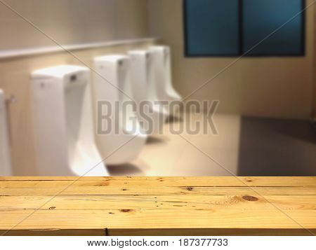 Empty wooden table space platform and blurred Toilet background for product display montage.