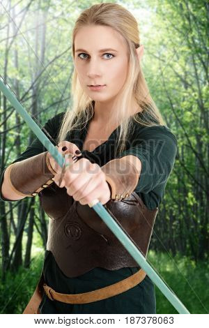 female wood elf using bow and arrow