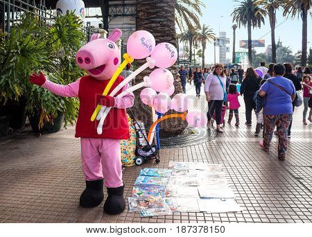 SANTIAGO CHILE - OCTOBER 28 2016: Street seller in Peppa Pig costume near Central Station. This is one of the most crowded places in the city.