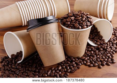 Paper coffee cups with lid and coffee beans