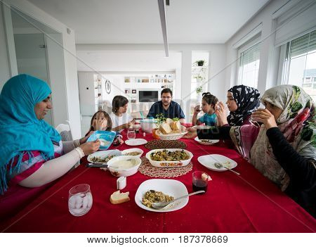 Arab family eating food on the table at home