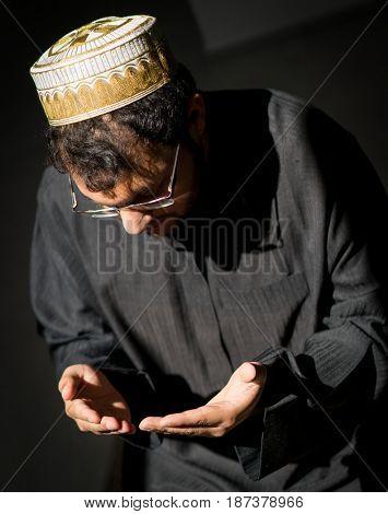 Muslim Arabic man praying