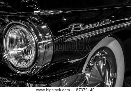 STUTTGART GERMANY - MARCH 04 2017: Headlamp of full-size car Pontiac Bonneville 1960. Close-up. Europe's greatest classic car exhibition