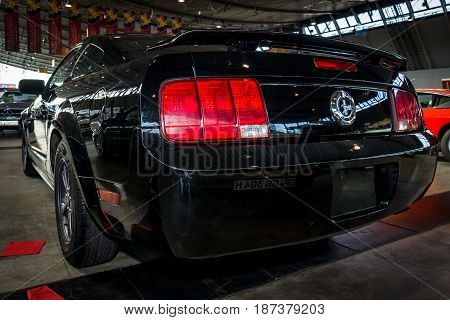 STUTTGART GERMANY - MARCH 04 2017: Pony car Ford Mustang V6 Coupe 2006. Rear view. Europe's greatest classic car exhibition
