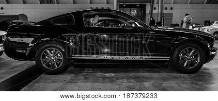 STUTTGART GERMANY - MARCH 04 2017: Pony car Ford Mustang V6 Coupe 2006. Black and white. Europe's greatest classic car exhibition