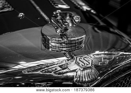 STUTTGART GERMANY - MARCH 04 2017: Hood ornamental car of Jaguar SS 100 (Jaguar in the jump). Black and white. Europe's greatest classic car exhibition