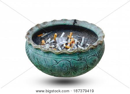 Cigarette butts in the ashtray on white background