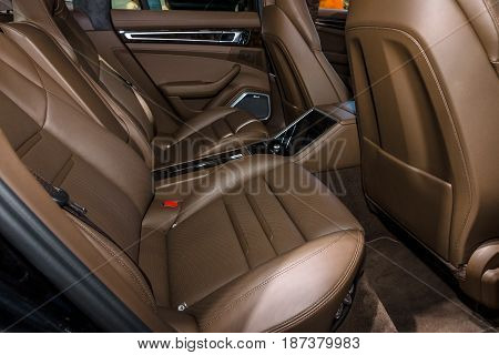 STUTTGART GERMANY - MARCH 04 2017: Interior (passenger seat) of full-size luxury car Porsche Panamera Turbo 2016. Europe's greatest classic car exhibition