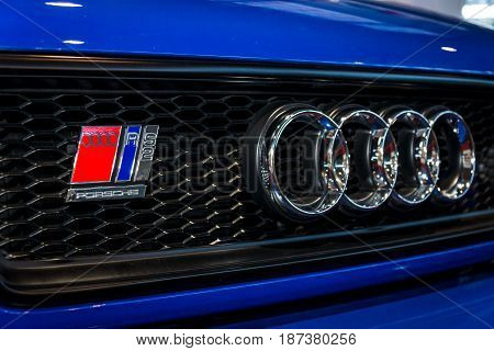 STUTTGART GERMANY - MARCH 04 2017: Emblem of an entry-level luxury car Audi RS 2 Avant 1995. Europe's greatest classic car exhibition