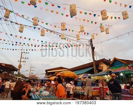 KAMPHAENG PHET THAILAND - MAY 6 : unidentified people or tourists walking around Nakhon Chum street market in the evening on May 6 2017 in Kamphaeng Phet Thailand.