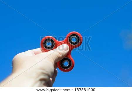 Man Playing With A Fidget Spinner