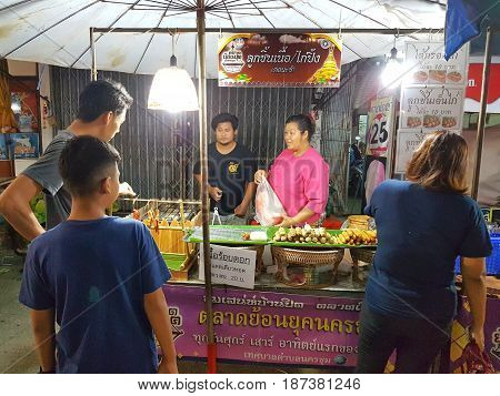 KAMPHAENG PHET THAILAND - MAY 6 : unidentified asian woman with Thai traditional clothing selling meatballs in Nakhon Chum street market on May 6 2017 in Kamphaeng Phet Thailand.