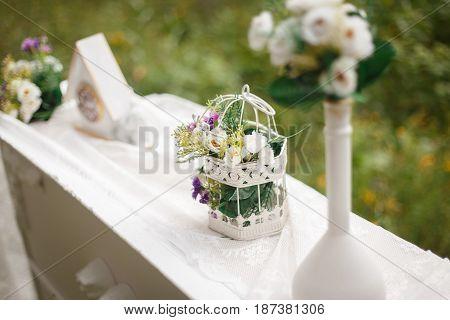 Wedding Decoration. Clock, Bouquet On Table