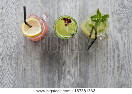 Row Of Fruit Drinks On Wooden Surface With Copy Space